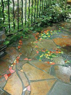 Mosaic inserts in flagstone walkway