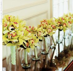 green orchids + yellow roses + white plumerias