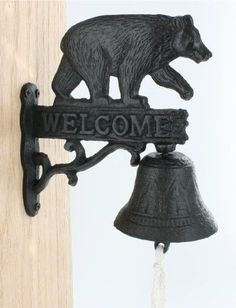 Black Bear Bell . $19.99. Black bear bell made of cast iron. Approx 8x6. Welcome all your guest with this black bear with bell.You can hang this bear anywhere outside and let your guest ring the bell.This black bear decor is a sweet addition to your outdoors.It is designed to weather the elements and arrive ready to hang on any home post, tree.This is a plus for your outdoor decor.