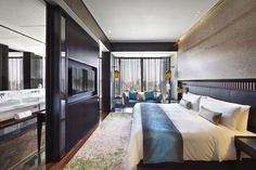 NUO Hotel Beijing's Deluxe Rooms exude the elegant simplicity of a Ming Dynasty scholar's personal chambers. Bedecked in a soothing palette of cream and celestial blue.