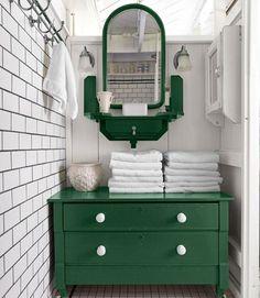 Flea-market-chest-turned-bathroom-storage; painted Rust-Oleum's Hunter Green.    #bathroom #storage