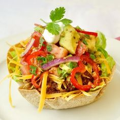 Low Fat Taco Salad with Chunky Avocado Tomato Salsa - a healthy mix of flavors and textures. You'll love the crunchy baked tortilla bowl!