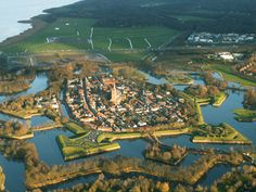 Naarden | an example of a star fort, complete with fortified walls and a moat. one of the best preserved fortified towns in Europe and especially famous for its unique star shape