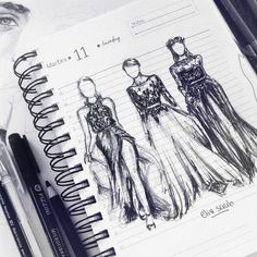 Fashion sketches in notebook