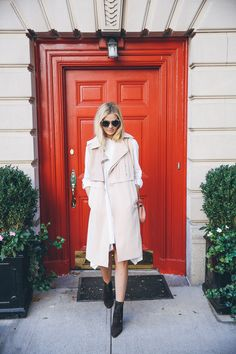 Barefoot Blonde Amber Fillerup wearing Three Floor sleeveless trench and DKNY dress