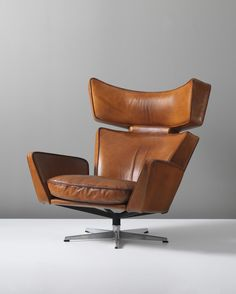 ARNE JACOBSEN 'The Ox' lounge chair, circa 1966 Leather, chrome-plated metal, painted metal. 101.5 x 97 x 76 cm (39 7/8 x 38 1/4 x 29 7/8 in) Produced by Fritz Hansen, Denmark.