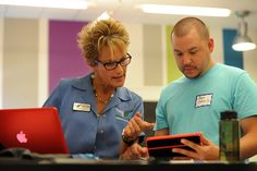 School counselor Dale Bonavita and Aaron Guthrie Sr. discuss concurrent enrollment in college coursework for high school students Aug. 2 at Falcon Virtual Academy in Falcon School District 49. Guthrie's daughter will enroll in college-level English classes while finishing 11th grade at the academy, as his son starts ninth grade. Roughly 75 students were attending high school orientation at the K-12 blended-learning facility.