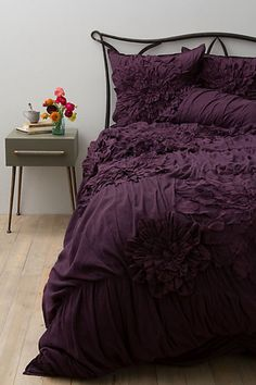 Oooo, I so want a big heavy eggplant purple comforter like this!  I love the color and texture :). King size