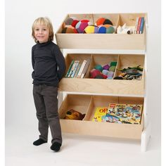 The Toy Store is an innovative storage system with three tiers of storage bins, ideal for books and toys. Description from oeufnyc.com. I searched for this on bing.com/images
