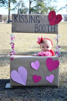 I put together a 'kissing booth' for my daughter's Valentine Day pictures. I made the box from a cardboard box, wooden rod, wrapping paper, scrapbook paper, and curling ribbon. Easy Peesy!