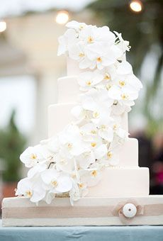 classic, five-tier white wedding cake decorated with orchids.
