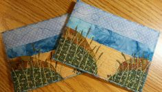 """Quilted Postcards  Send a """"forever card"""" to someone special. It can be mailed, and then framed since it is a piece of art. You can also stand it on an easel. This mini art quilt features a beach scene with thread painted grasses. Features: • Each postcard is individually made with much care and attention to detail • Measures 4.25 inches x 6.25 inches • Made with cotton batting, polyester threads, and 100 % cotton fabrics. Also contains a stabilizer. • Made in a smoke-free home • Fabrics are…"""