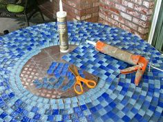 Old glass patio table, pieces of glass tiles makes a beautiful table