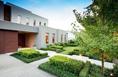 Exterior, Luxurious A Stunning Retreat Home Landscaping Idea Involving Bushes And Greenery To Hit Gray Themed Building: Extraordinary Modern Exterior House with Swimming Pool
