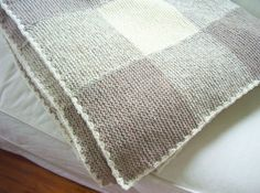 Can you make a modern blanket with a simple checkered pattern? Yes, you can!  http://www.themodernknit.com/2014/06/29/checkered-knitted-blankets-neutrals/