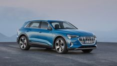 After months of teasers and leaked images, Audi have officially revealed the all-electric crossover. The 2019 Audi E-Tron is powered by two powerful electric motors that are locally and virtually silent. The motors are powered by a 95 Audi Rs7, Audi Quattro, Electric Crossover, Hybrids And Electric Cars, Automobile, Tesla Model X, Cars Uk, Audi Sport, Surabaya