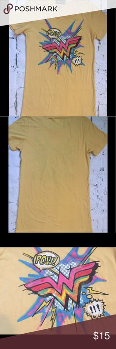 """Junk Food Wonder Woman Graphic T-Shirt Yellow S Excellent condition, no signs of wear, actually never worn. Size small, slim snug fit. ✔️Measures: 25.5"""" length neck to hem, 15.5"""" pit to pit. Fits more like XS. Cotton blend, made in US.  LMK if you have any question, thanks a bunch💋 Junk Food Tops Tees - Short Sleeve"""