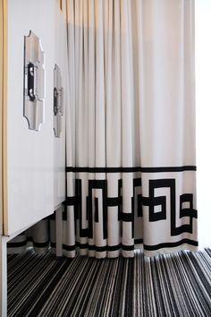off set large Greek Key type bottom banded drapery panels