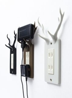 Antler outlet plates to hold devices while they charge