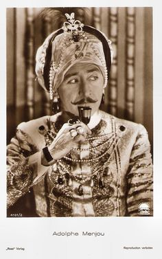 https://flic.kr/p/Q2awrY | Adolphe Menjou in His Tiger Wife (1928) | German postcard by Ross Verlag, no. 4101/2, 1929-1930. Photo: Paramount. Publicity still for His Tiger Wife (Hobart Henley, 1928). Suave and debonair American actor Adolphe Menjou (1890-1963) with his trademark waxy black moustache was one of Hollywood's most distinguished stars and one of America's 'Best Dressed Men'. He started as a matinée idol in the silent cinema in such classics as Ernst Lubitsch's The Marriage…