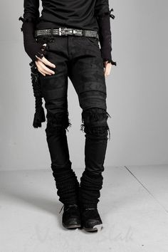 Post apocalyptic style with destroyed denim . All black everything dark outfit