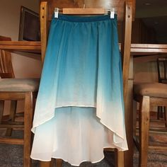 STUNNING F21 Ombré High Low Skirt This skirt is so lovely. It has an invisible zip up the side with a hook and eye closure at the top. The skirt is high low and has a lovely fade from turquoise at the top to a cream color at the bottom. It moves gorgeously when walking or in the wind. It has a lining as well. It feels like silk and is a favorite of mine, but I just haven't worn it lately. It's in perfect condition. 🚫No Holds 🚫No Trades ❌🚬smoke free home 👍Negotiate using the offer button…
