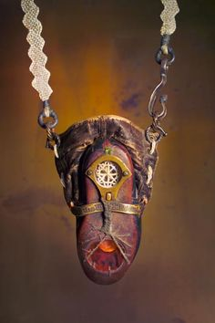 Keith Lo Bue - To the Invisible Girl. 2011 Victorian child's boot, 19th-century drawer pull, antique linen & rayon, Celtic money rings, waxed linen thread, fork tines, brass, copper, steel, antique bobbin lace, 1860 tintype, glass fused  portrait, eucalyptus acorn cap, 19th-century engraving, sea urchin spines, velvet, 19th-century magazine photograph & book-liner fabric, labradorite, peridot, resin, Victorian pen nib, lens, choko nut, copper tacks, spiral-shank nails, 16th-century paper…