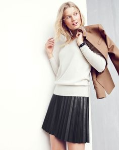 J.Crew women's Regent blazer, Collection cashmere V-neck sweater, sunburst mini skirt in faux leather and horseshoe hoop earrings. To pre-order, call 800 261 7422 or email verypersonalstylist@jcrew.com.