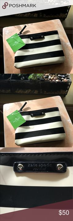 "Kate Spade York Street Top Zip Mini Pouch Striped Kate Spade York Street Top Zip Mini Pouch Black & Enoki Stripes.  • Printed Faille Under Clear PVC With Coated Cotton Twill Trim.  • Wipeable Nylon Lining.  • 14K Light Gold Plated Hardware  • Interior Double Side Pockets.  • Measures: 4.7""h X 6.6""w  • NWT...Retails for $78.00   **Please see all Pictures!! This pouch is New With Tags however there are a few small spots where the black has bled, I have not tried to remove them, unsure if they…"