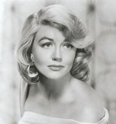 Dorothy Malone(1925-),American movie actress,after her performance in Written on the Wind (1956), for which she won the Academy Award for Best Supporting Actress. Her film career peaked by the 1960s, and she achieved later success with her television role as Constance MacKenzie on Peyton Place from 1964 to 1968. Less active in her later years, Malone returned to films in 1992 as the friend of Sharon Stone's character in Basic Instinct.