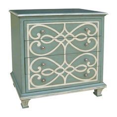 Traditional accent chest with scrolling motif and distressed blue finish.  Product: Chest  Construction Material: