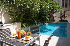 not keen on pool edge with raised bed, also lots more pool maintenance with frangipani over the water....not keen