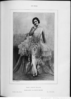 """Les modes (Paris), July 1928. Evening dress forming a large pouf of pink tulle; tablier [lit. """"apron""""] embroidered with pearls and diamonds; big bow of tulle on the side."""
