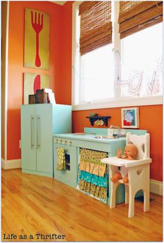 Kitchen in the kitchen. Love this idea of putting your kids kitchen in your kitchen...except I know how messy my kids can be.  Maybe they should keep their mess out of my space.  lol