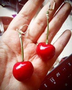 Handmade retro cherry earrings to complete your pinup look! Perfect for a summers day or any occasion or event. Handcrafted from glossy faux cherries with plastic stems, hand-wrapped with stainless steel wire and attached to stainless steel ear wires with hinge and shell detail or to stainless steel clip on earrings (your choice). Each earring measures 3 inches in length and 1 inch wide at the ball of the cherry. Both earrings together weigh less than 1 ounce.