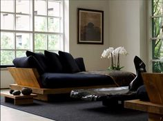 Urban Zen - home---- I could very easily curl up w/ a good book on this couch!  It would easily be a favorite space!!!