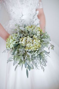 The bride's bouquet of baby's breath, eucalyptus and green hydrangeas