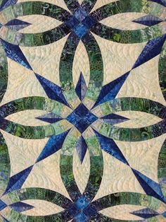 Kitsap Quilters' Guild 2016 raffle quilt.  Pieced by guild members and machine quilted by Marybeth O'Halloran.  Bali Wedding Star pattern by Judy Niemeyer.  Photo by Maggie Ball | Dragonfly Quilts.