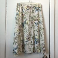 Side slit midi skirt Muted floral midi skirt! Has two slits in front. Perfect for spring and summer. New Look Skirts Midi