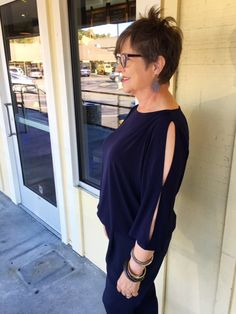 Wearing a cold shoulder top on Brenda Kinsel website