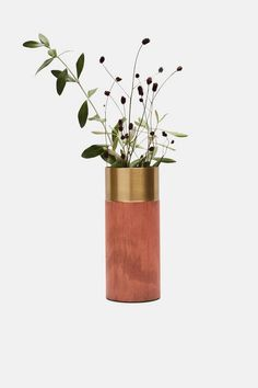 """This vase reveals a color combination that is organic and inherent to brass. The bipartite effect is created when the entire vase is oxidized, and one strip—at the top—is cleaned and polished. """"By showing both the original and oxidized color in one product, the viewer is made aware of its material qualities."""""""