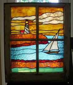 Stained Glass Sailboat Panel in Old Window Frame. $475.00, via Etsy.