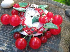 Charming Vintage Bakelite and Celluloid Cherry Bracelet with Leaves, 1930's to 1940's. $199.00, via Etsy.
