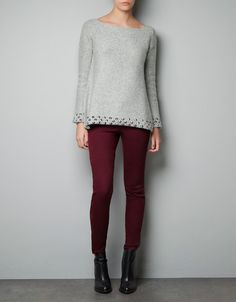 Knitted sweater with studded detailing