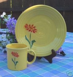 Sunflower Fiesta® Java Mug and Luncheon Plate features a single Tangerine flower. Made by Homer Laughlin China Company | WorthPoint