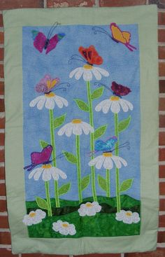 Butterflies & Daisies Baby Quilt. $120.00, via Etsy.