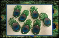 """Amazing """"Peacock Feather Nutter Butter Cookies"""" -- Made with commercial edible feather toppers; instructions at click-through."""