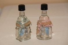 """Ball Jar Shot Glasses - Shower Favors Supplies: glass jar """"shots"""" glasses from Amazon.com, silver plastic rings and burlap ribbon from Michaels, mini Pearl wedding cake vodka bottles from Binnys Small dot of hot glue to hold the ribbon in place with knots to tie the rings on.  For Fun - tie 3 rings on a few shot glasses instead of 2 to designate a winner for the centerpieces or other prizes!"""