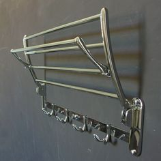A folding bathroom rack for towels, robes and clothing.