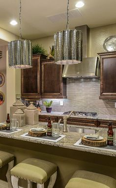 Come home to #captivating designs…. #newhome #kitchen #darkwood #cabinets